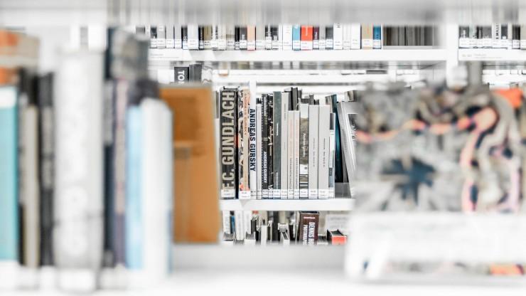 Library books on white shelves