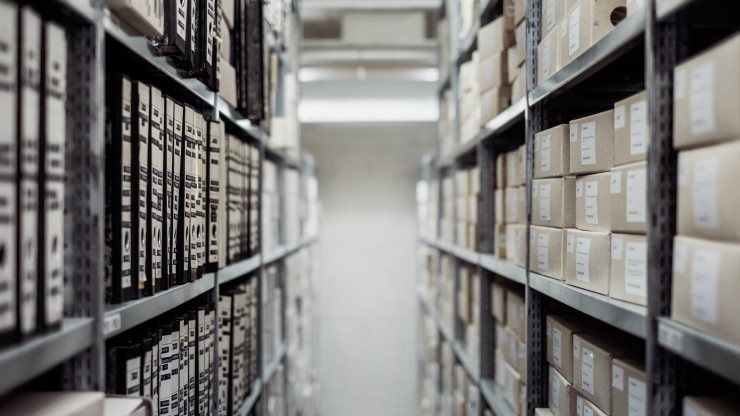 Image of storage for special collections materials: archival boxes on shelves