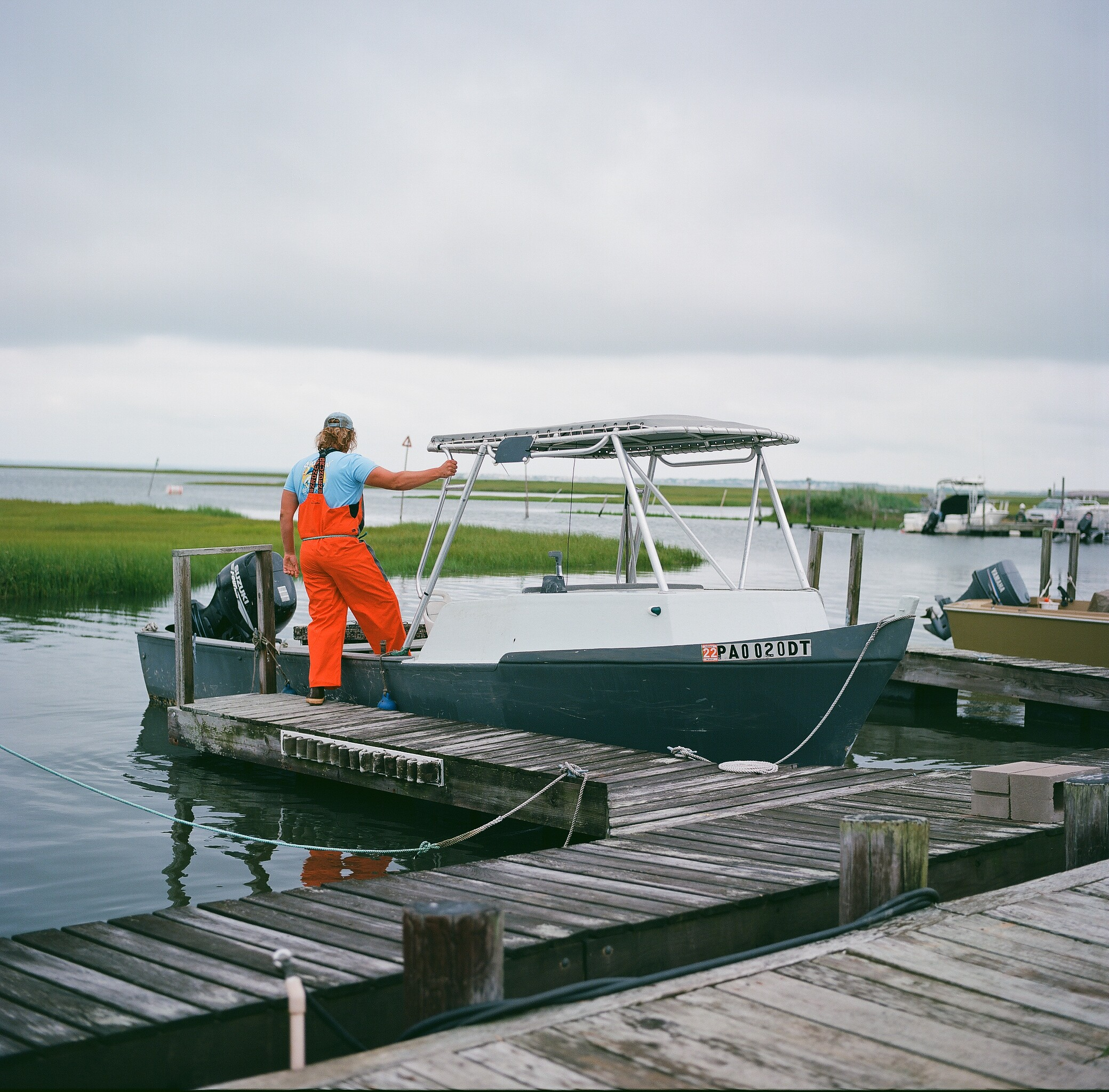 Sean heading out to harvest oysters, shot on medium format film.