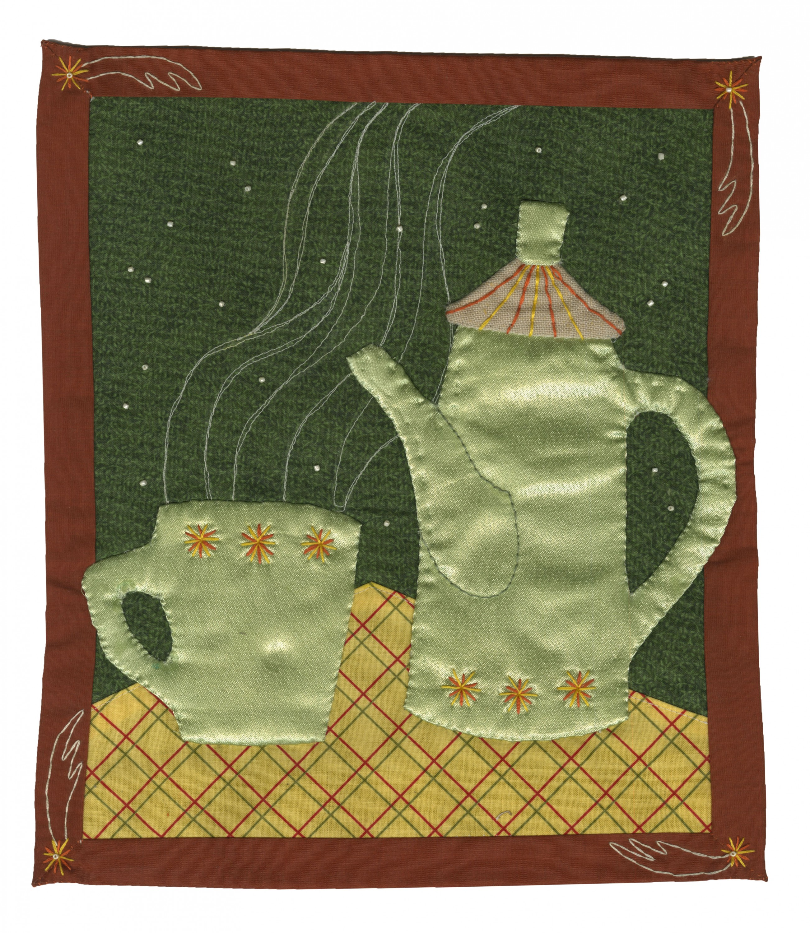 There is an applique that shows a light green midcentury coffee pot and a matching mug on a dark green background. it has an orange frame with shooting stars embroidered on the corners. it is sewn onto the back of a denim jacket, with yellow fringe above