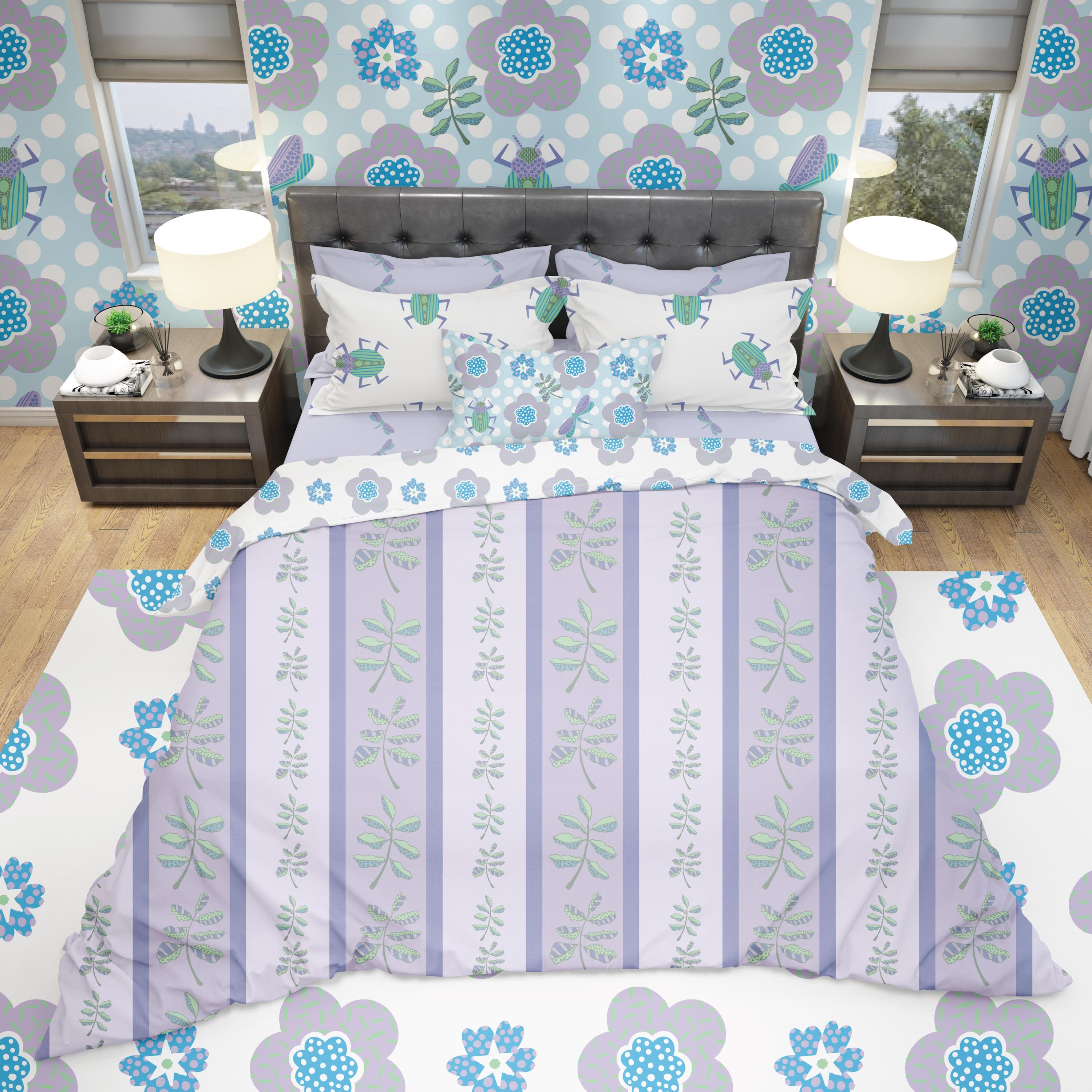 Image of a bed with drawings of insects and plants in a light color pallet of blue, green and purple. The top pillow has images of green beetles and the pillowcase below it has the same pattern as the bottom sheet which is of purple dragonflies.  A small