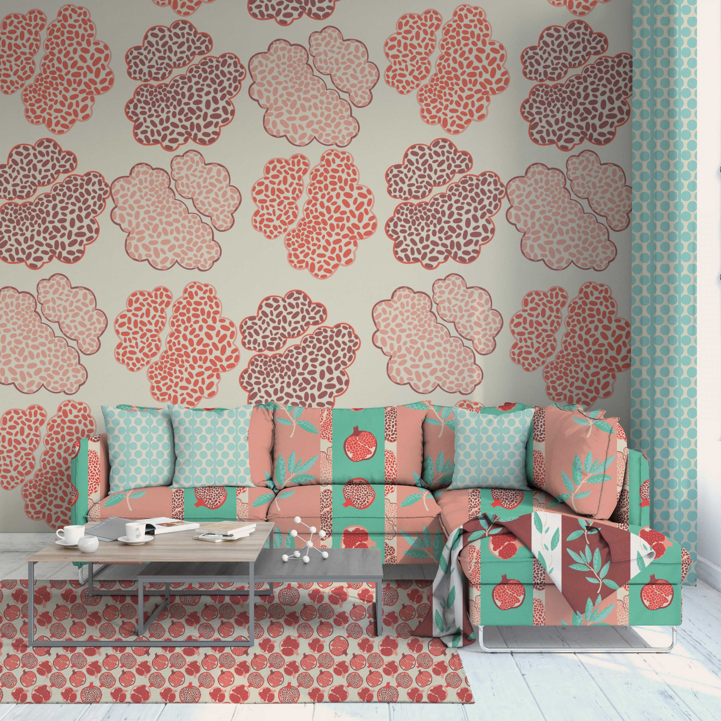 The second image is of the same living room but with a beige background of red and pink pomegranate seed pattern. The curtain and couch pillow have a beige and blue green polka dot pattern. The rug is of red and pink pomegranates with a beige background a