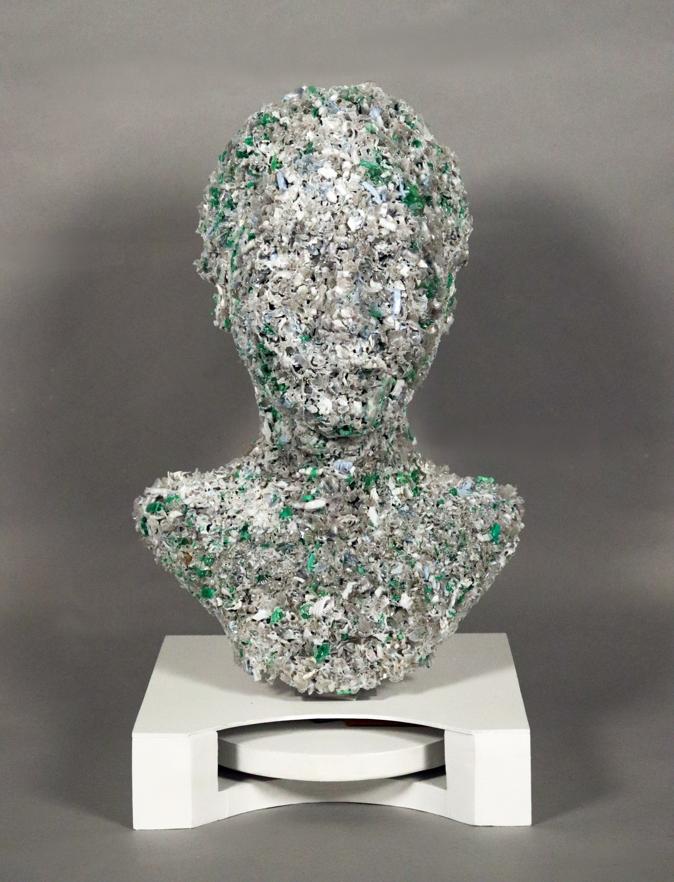 Female bust cast in recycled plastic chips, made from locally sourced water bottles