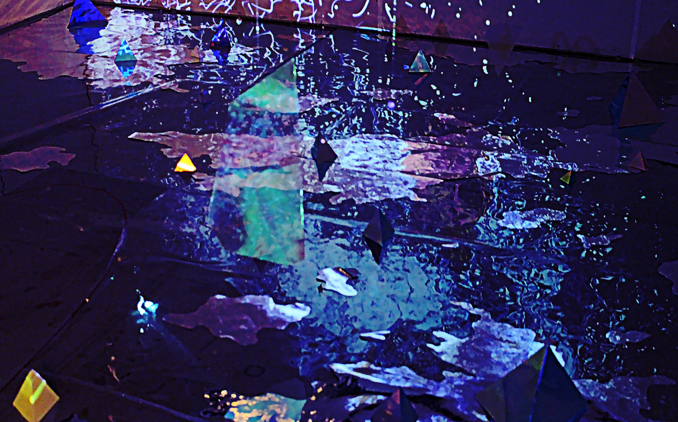 multimedia artwork created with the layers of iridescent acetate pieces, transparent mylar and motion video