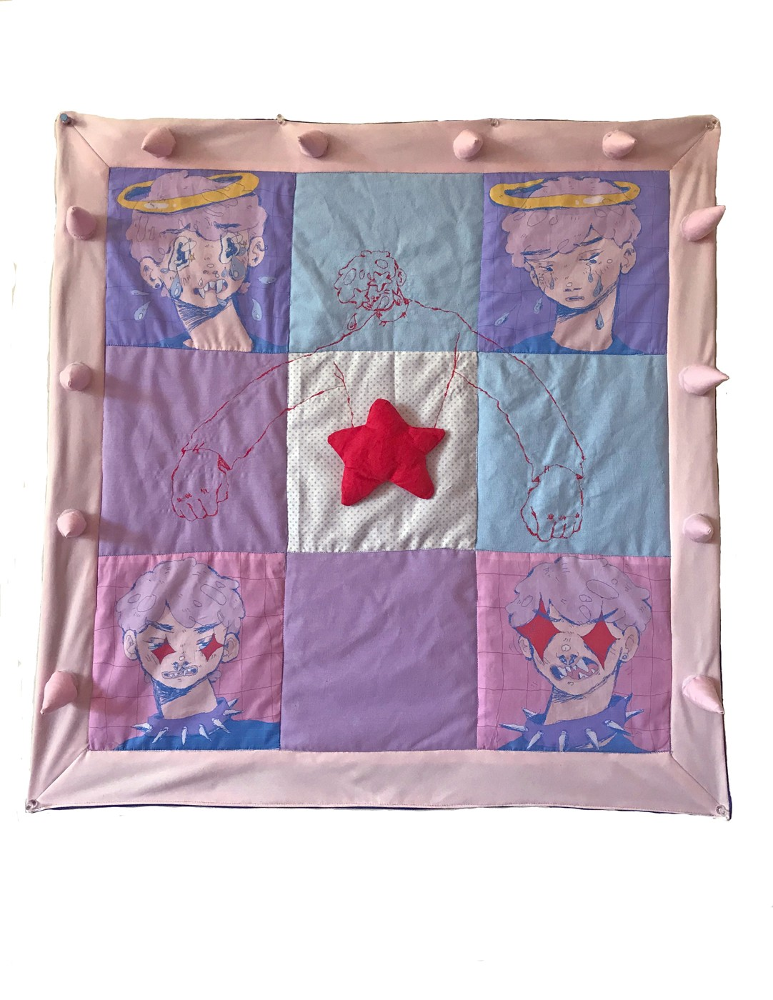Quilted squares surrounded by a border of soft-sculpture spikes. In the center is a 3-dimensional red star surrounded by four printed faces depicting various stages of emotional distress.