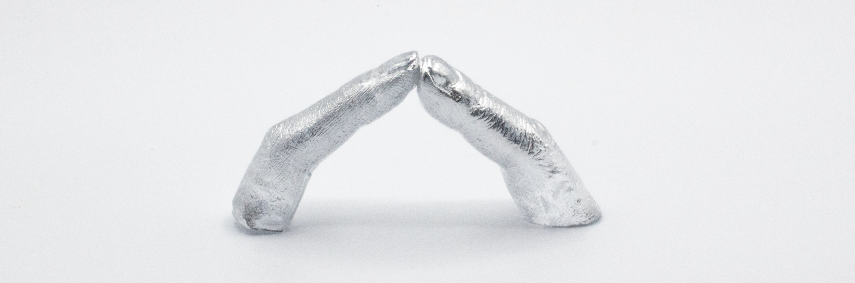 This piece has three series of pictures that indicated a process of two fingers touching each other. In the first picture, there is a transparent finger that stands as a single object, meanwhile, it has a steel spike reach out of the fingertip. The second