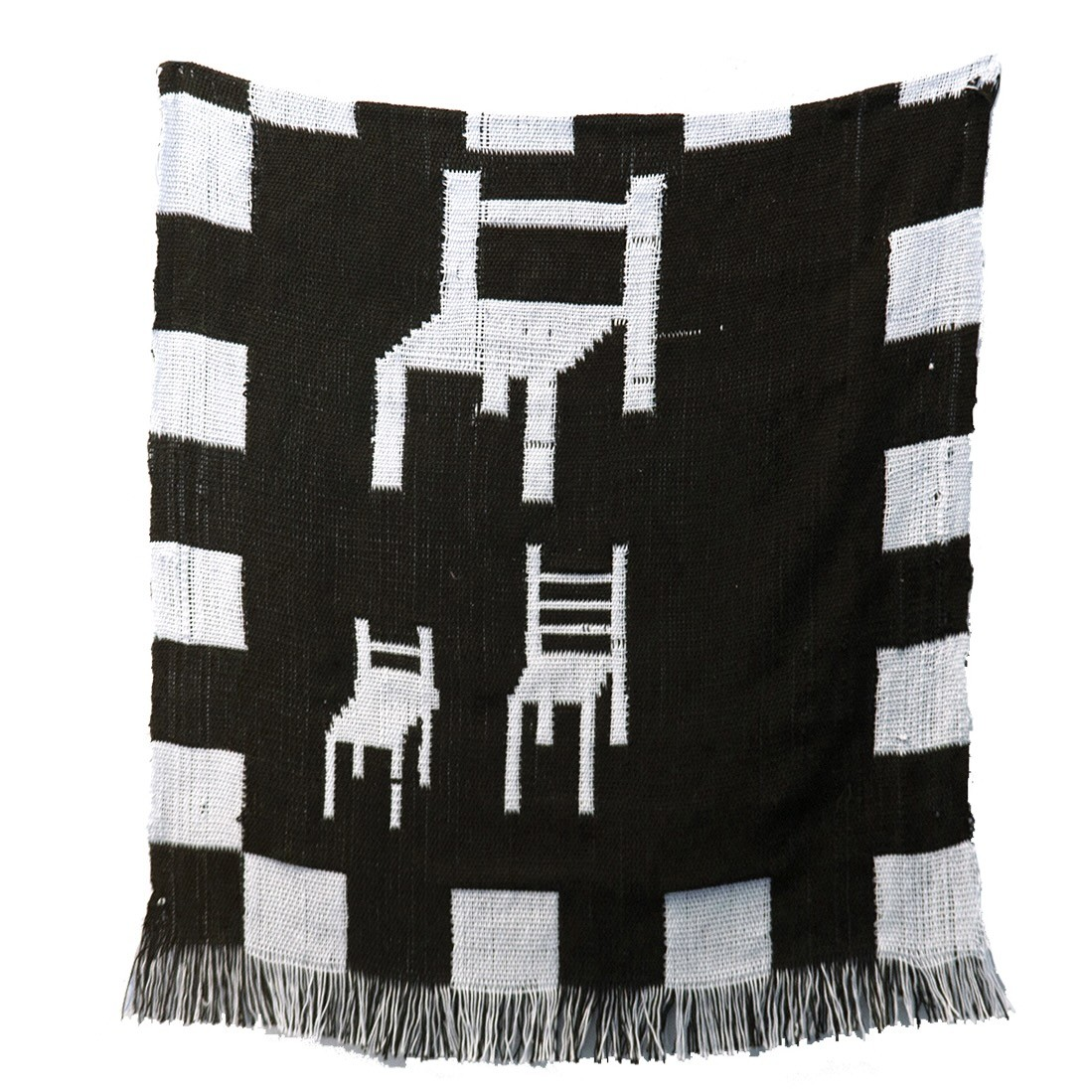 A black and white weaving set against a white background. A black and white checkerboard pattern runs along the edges of the weaving. In the center, three simple renderings of white chairs are set against a black field. Two inches of black and white fring