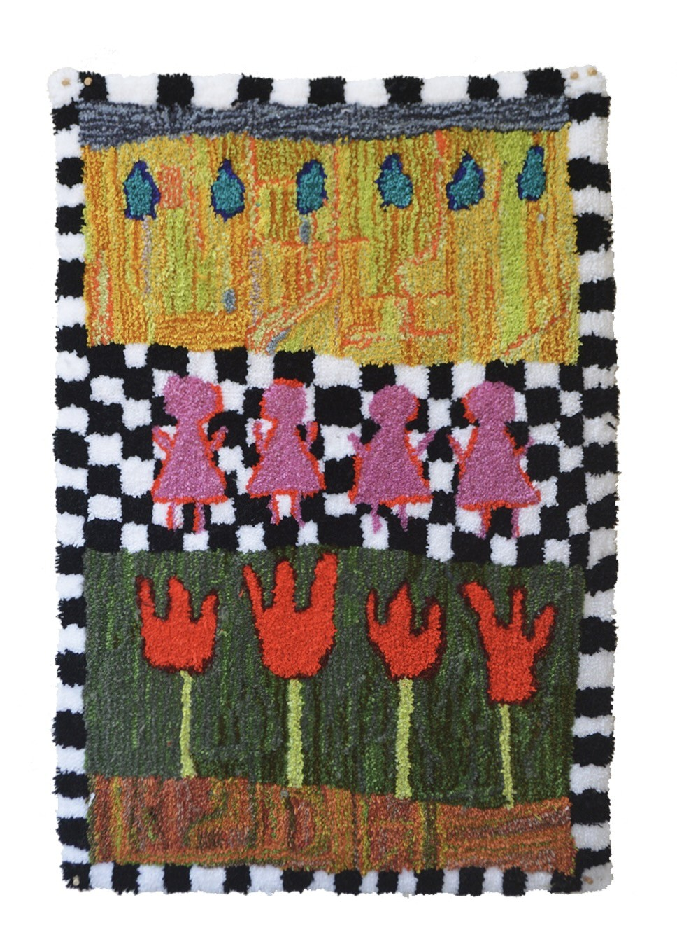 A shag carpet with a black and white checkerboard pattern around the edges of the piece. At the bottom of the rug, four red abstracted tulips sprout from a deep green field. Atop the tulips, against a black and white checkerboard, are four simplified huma