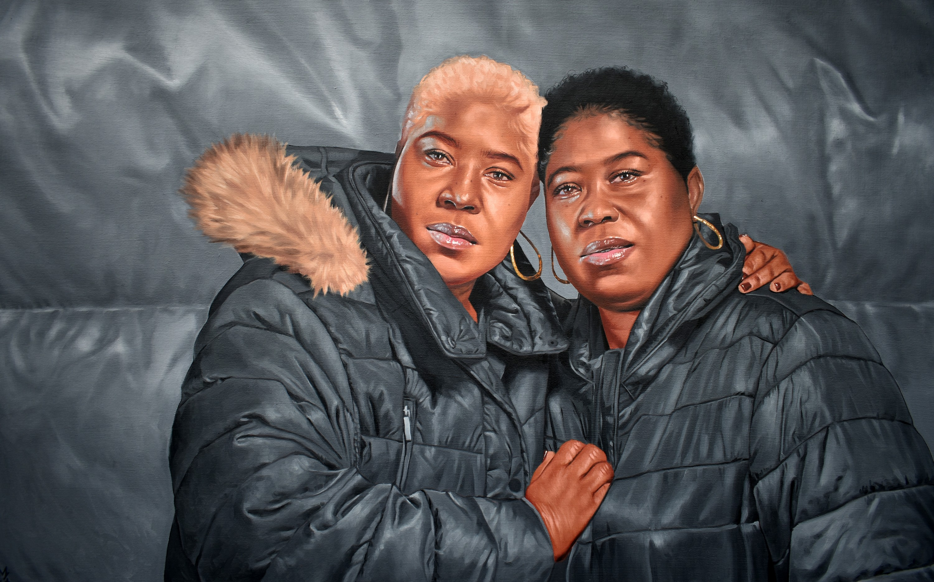 Painting of two women with one embracing the other