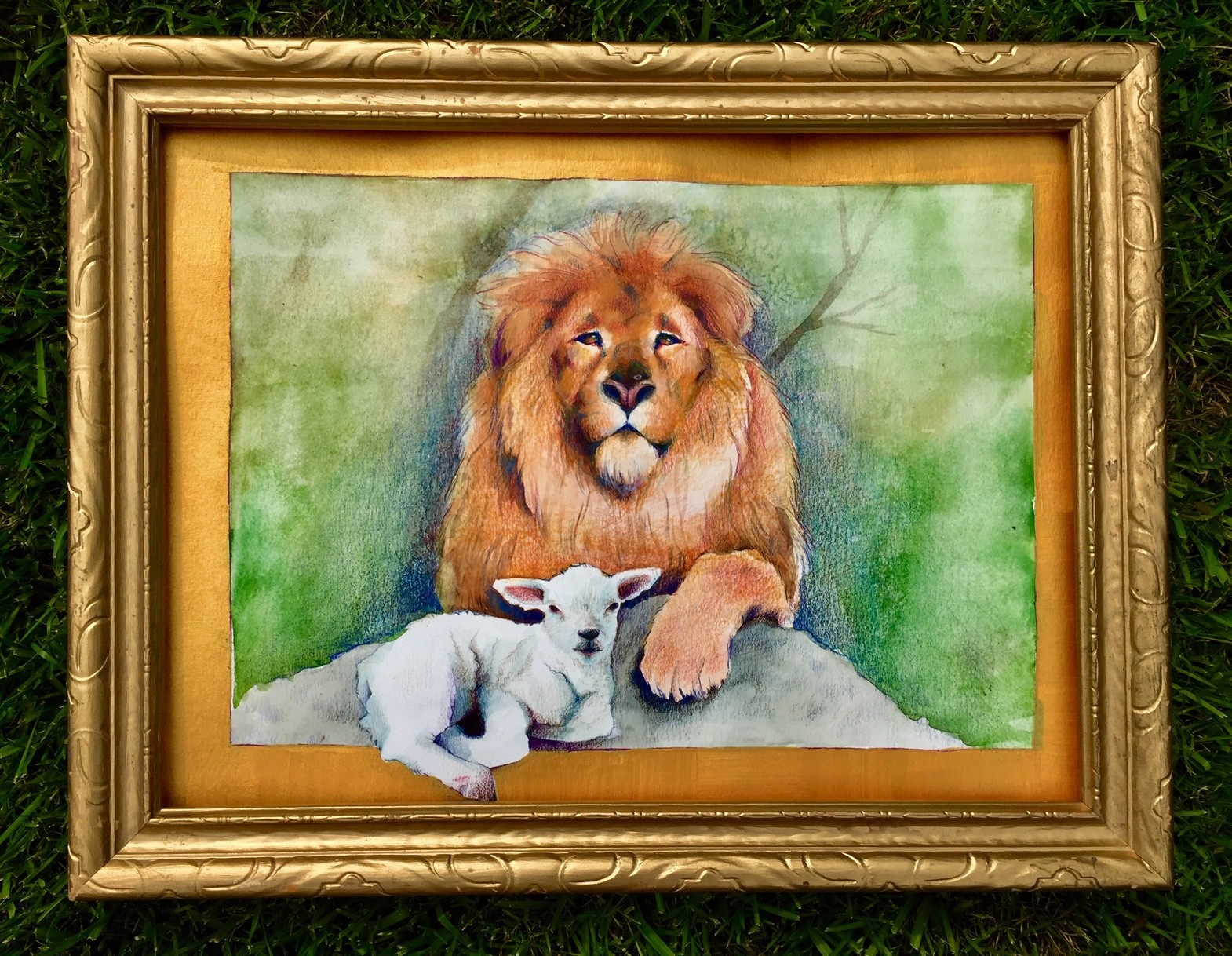 A lion and a lamb sit serenely with each other enjoying each others presence within a reign of peace.