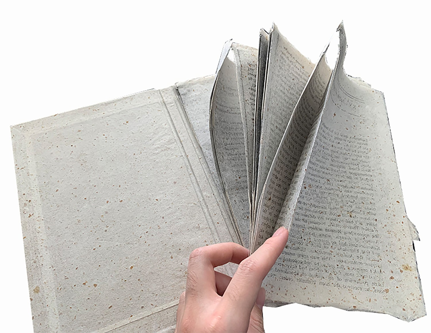 """""""The Book of Nonsense"""" showcases the fragility of knowledge and rationality. The words on the pages are manipulated in a way that the text is reversed, blurry, and overlapping-- unreadable. The paper for the pages is made from bread, which turns the perma"""