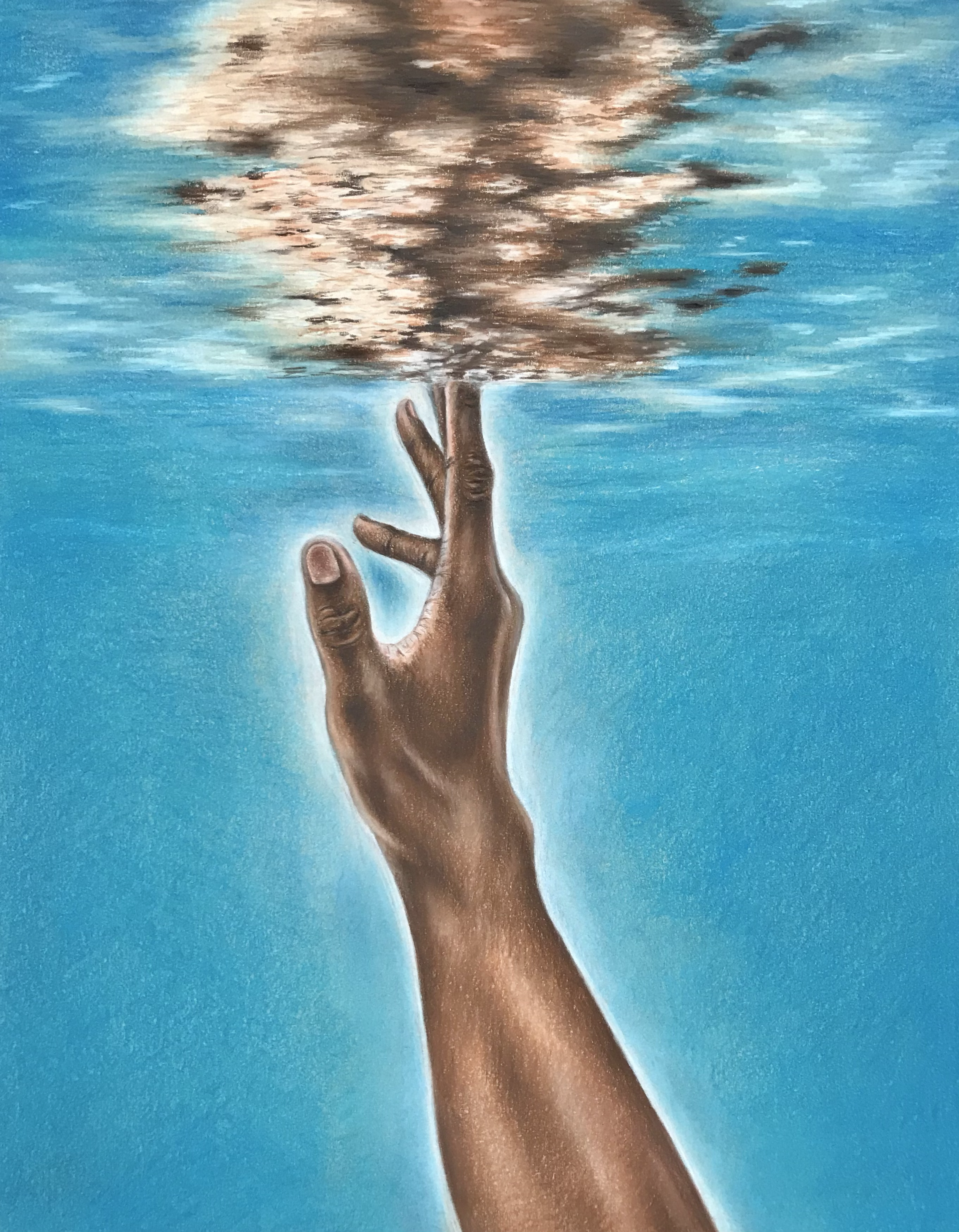 Hand underneath water reaching towards the surface.