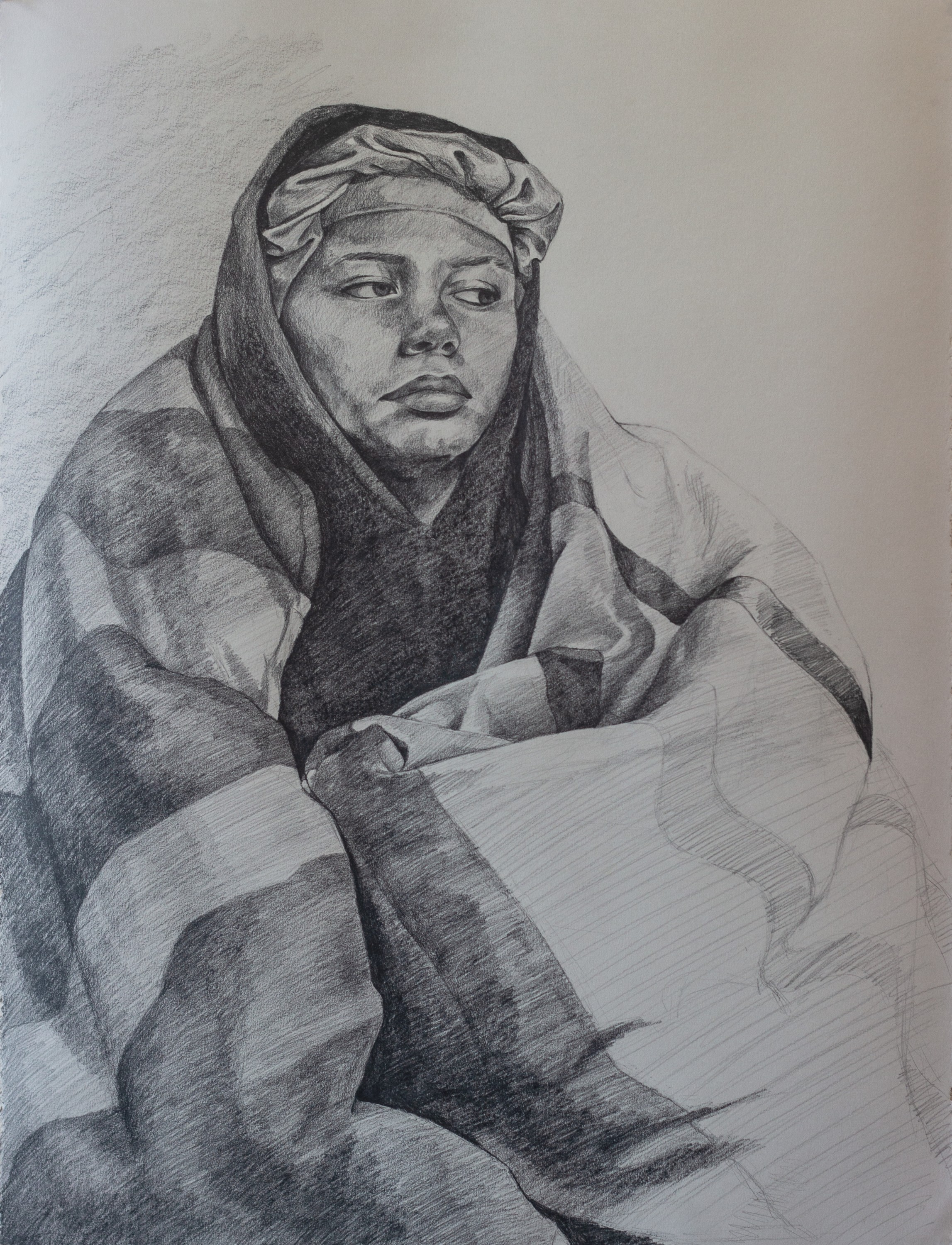 A graphite drawing of a figure wrapped in a striped blanket.