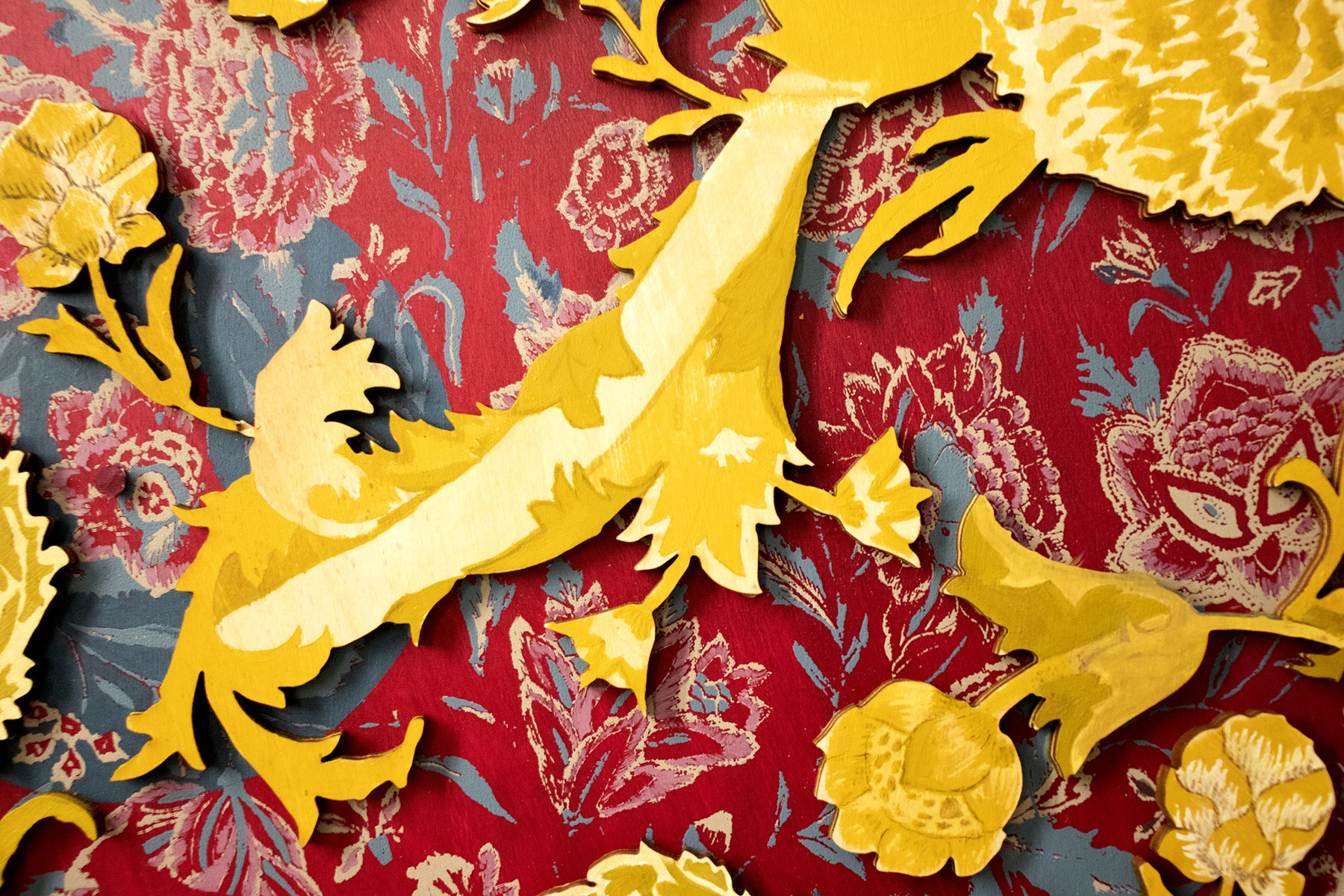 The English Aesthetic Movement? is a vibrant screen print wood consisting of two layers. The first layer portrays imagery of delicate flowers and birds while the second layer employs bold laser-cut flower motifs. While there is a distinct difference in th
