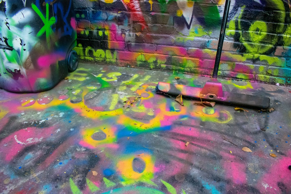 This image shows the negative shapes of the installation from the spray paint overspray.