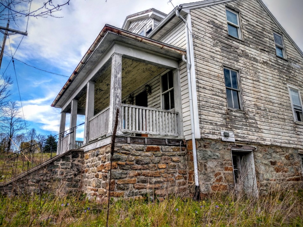 Various photographs of York County, such as abandoned railroad tracks and houses.