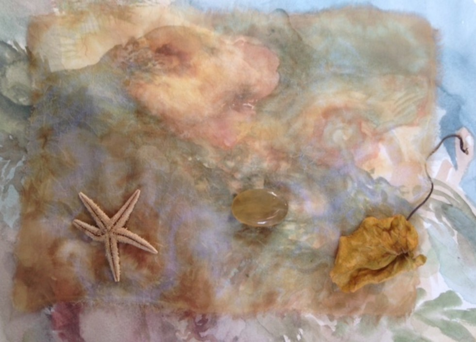 Painting with see through yellowish fabric on top, yellow crystal, yellow starfish and yellow leaf all on top of that--dreamy layers