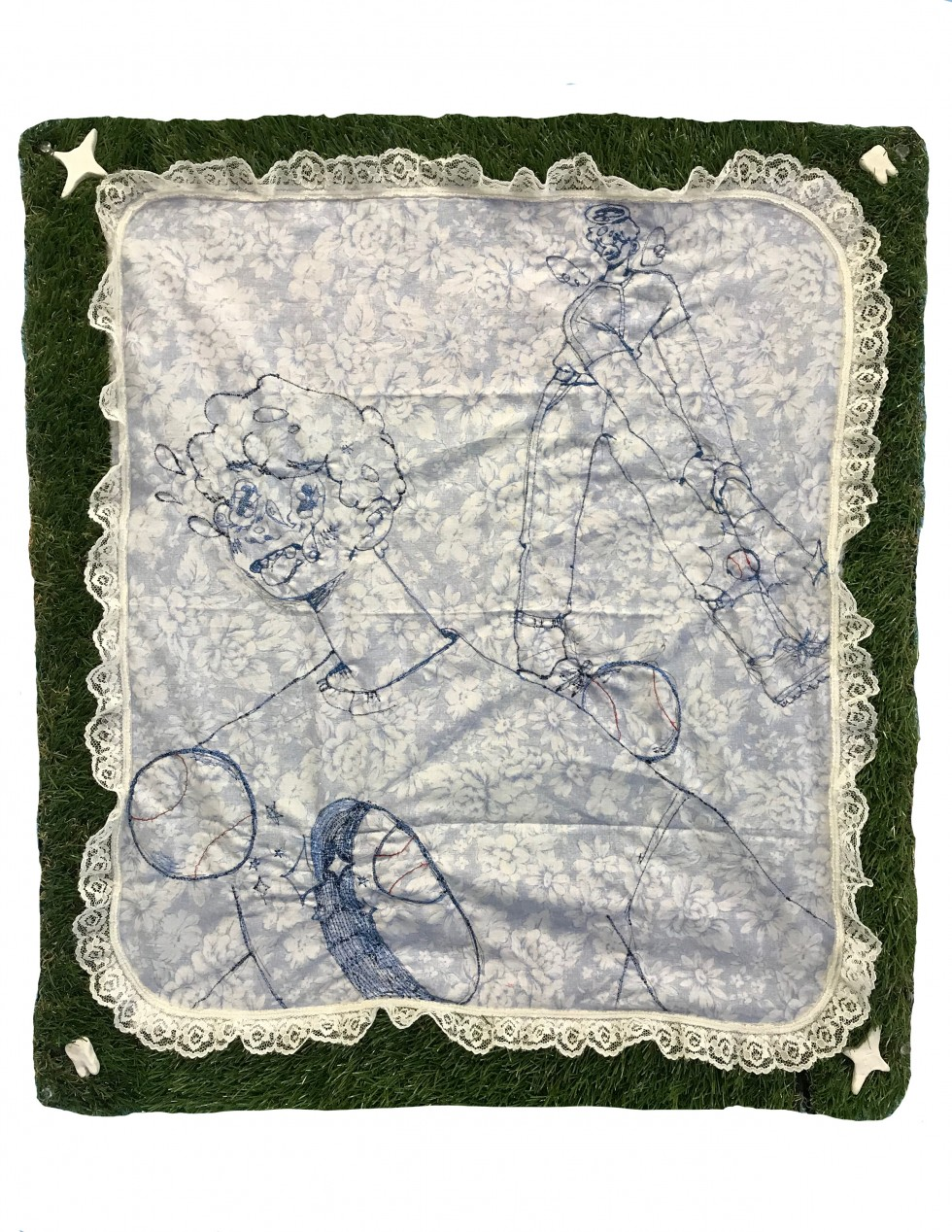 Embroidered drawing on floral fabric surrounded by a border of astroturf. The drawn image shows an angel hitting a baseball through a boy's chest. As the baseball enters his chest, a portal is opened up in the body for the ball to pass through.