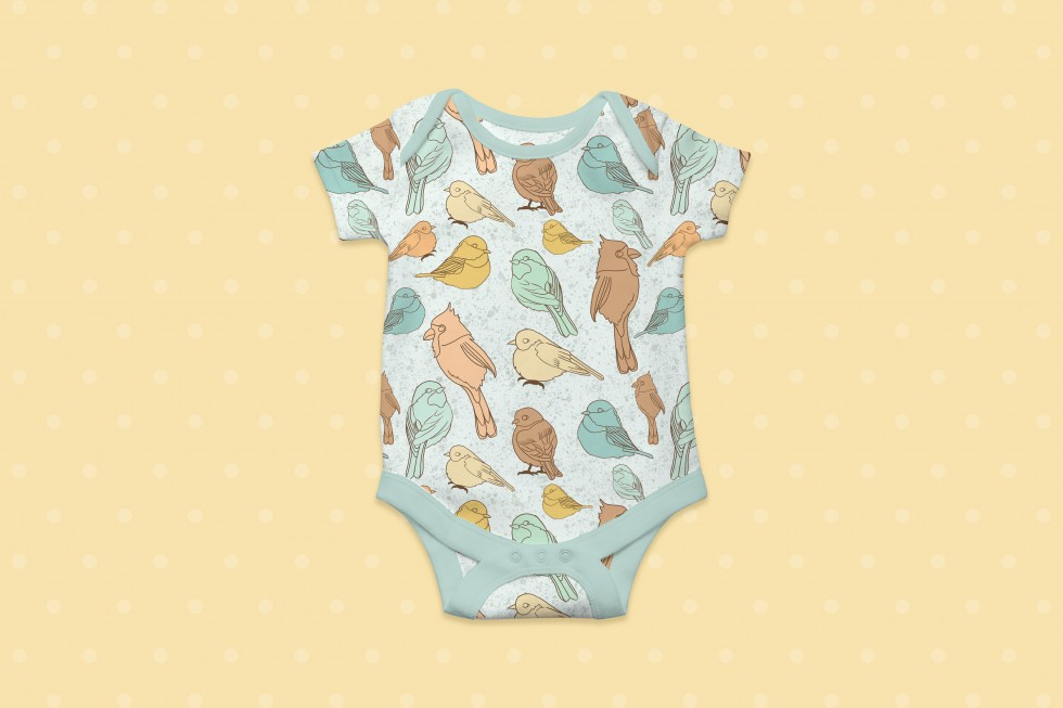 This is a surface pattern design for unisex baby clothing.  The subject matter of this design is birds, birdhouses and polka dots. Also, the pattern design uses soft colors, shapes and lines. The color palette contains, pastel yellow, orange and blues. Th