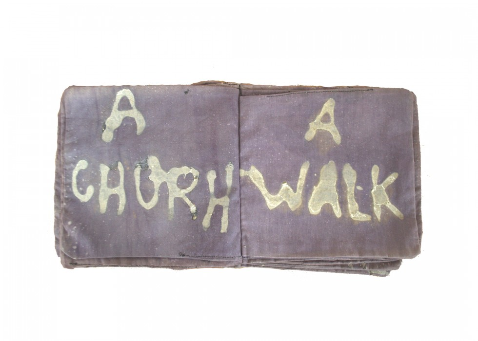 A simple cloth book in a muted purple shade. Each page has a stanza from the poem handwritten in white
