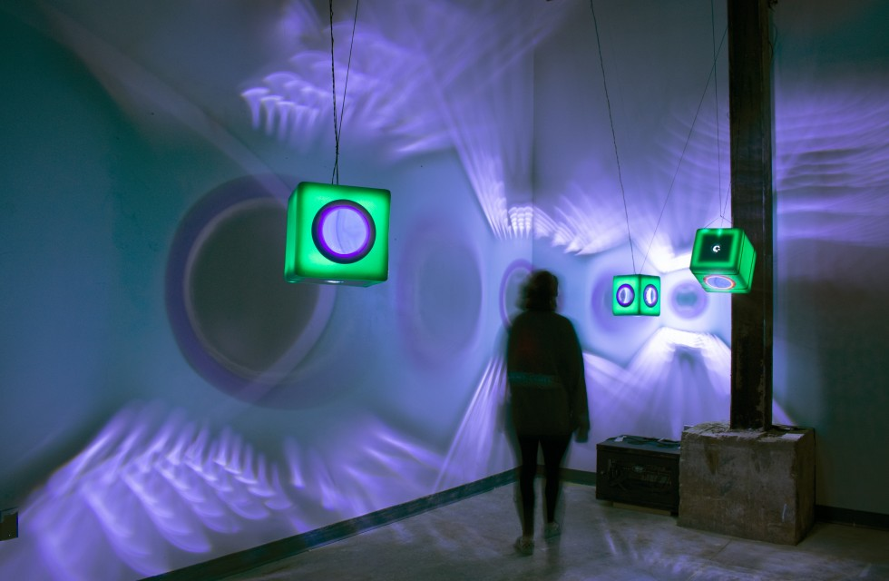 Installation using physical objects and light.