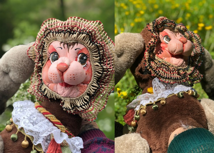 A magical goat puppet sits in a field of flowers. His two faces make it so much easier to take everything in. He has soft brown fur, a fancy neck frill, and lots of secrets. Will you sit with him for a moment?
