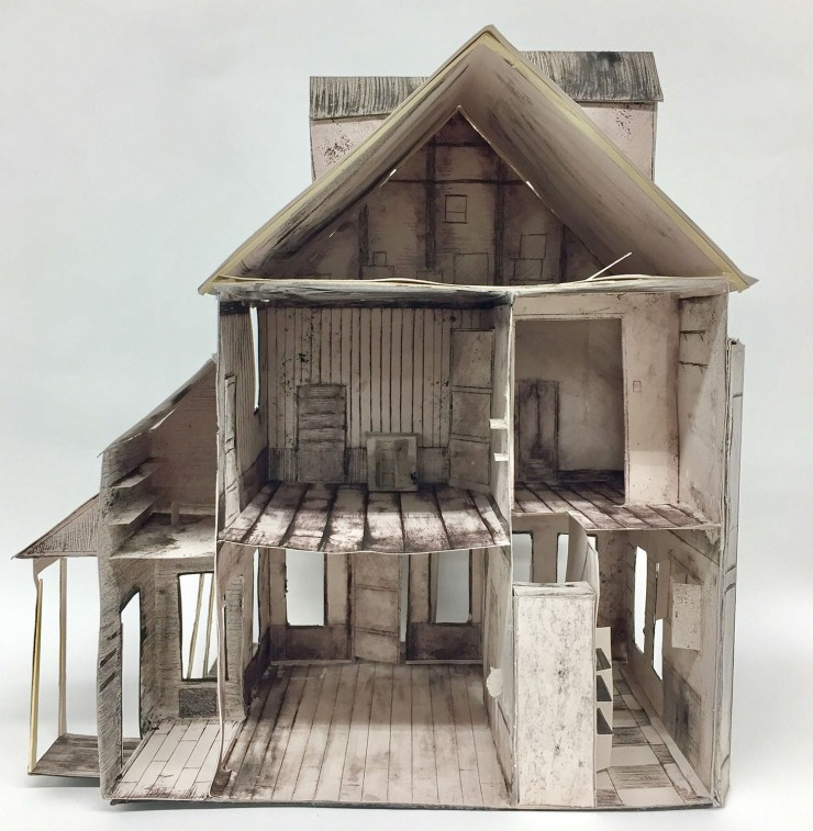 Three- dimensional paper house. 1:12 scale replica of an abandoned house.