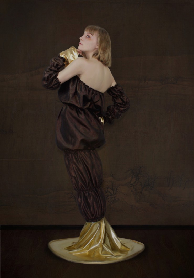 Long brown dress with gold flared lower skirt tail