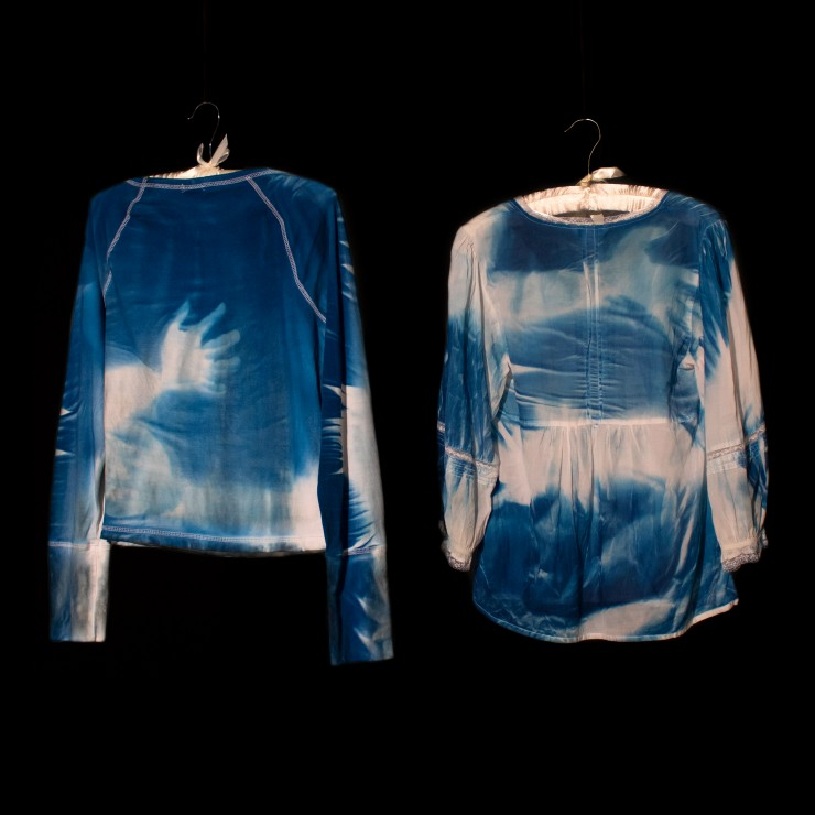 This image is documentation of contact prints of a hug between two people, recorded on garments. What remains is their ghostly imprint on one another, created through Cyanotype, a light sensitive chemistry. This work is the core of my thesis.