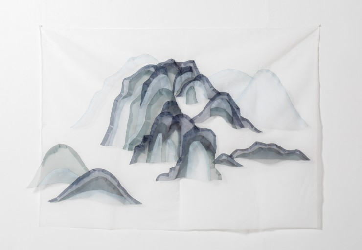 Flowing mountain scape made of transparent fabrics.