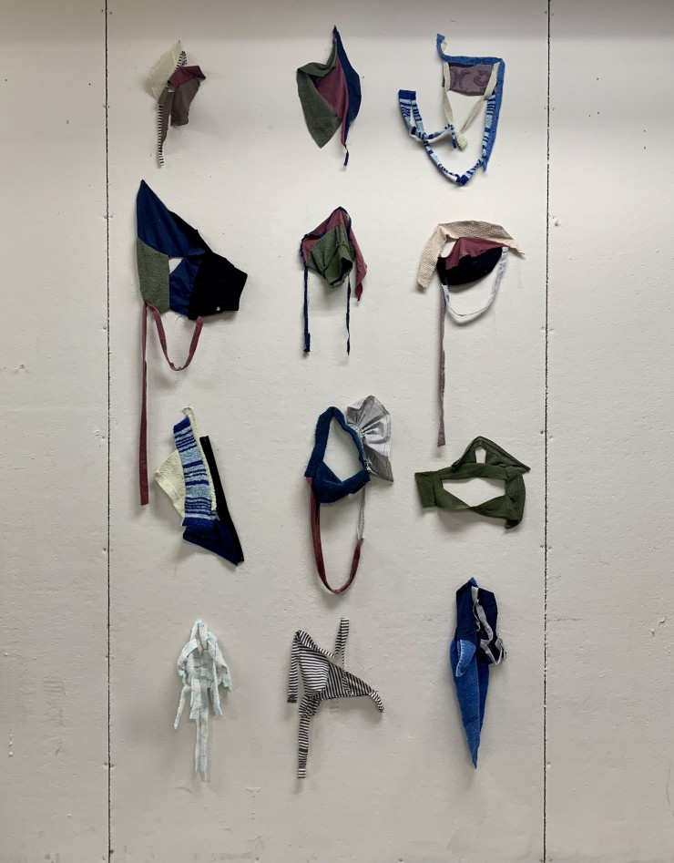 shaped pieces cut from used towels draped hung from the ceiling and dragged on to the floor.