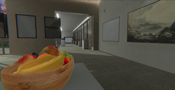 A bowl of fruit sits in the gallery space. Down the hallway are more food items on pedestals.