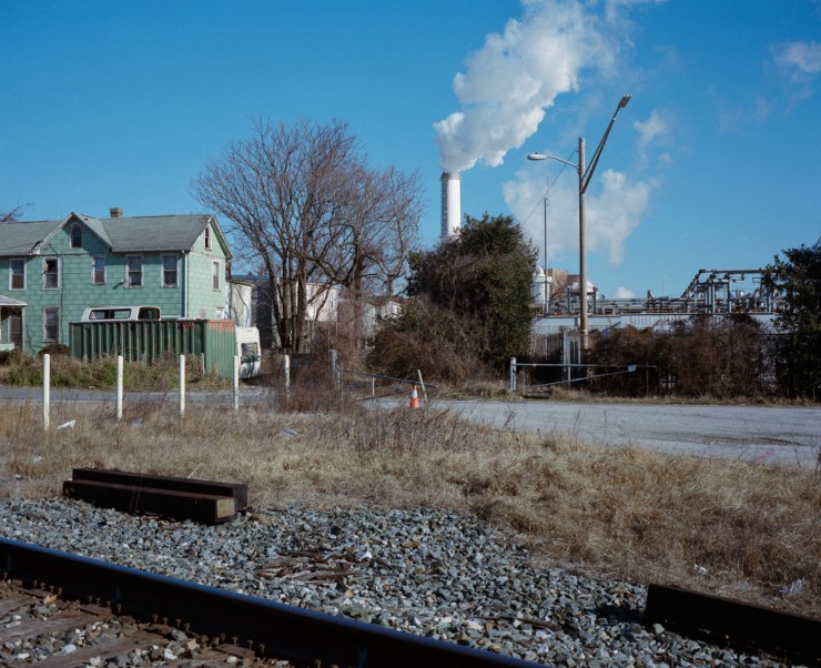 A photograph of the Wheelabrator Incinerator, which sits just beyond a set of row homes in the neighborhood of Westport.