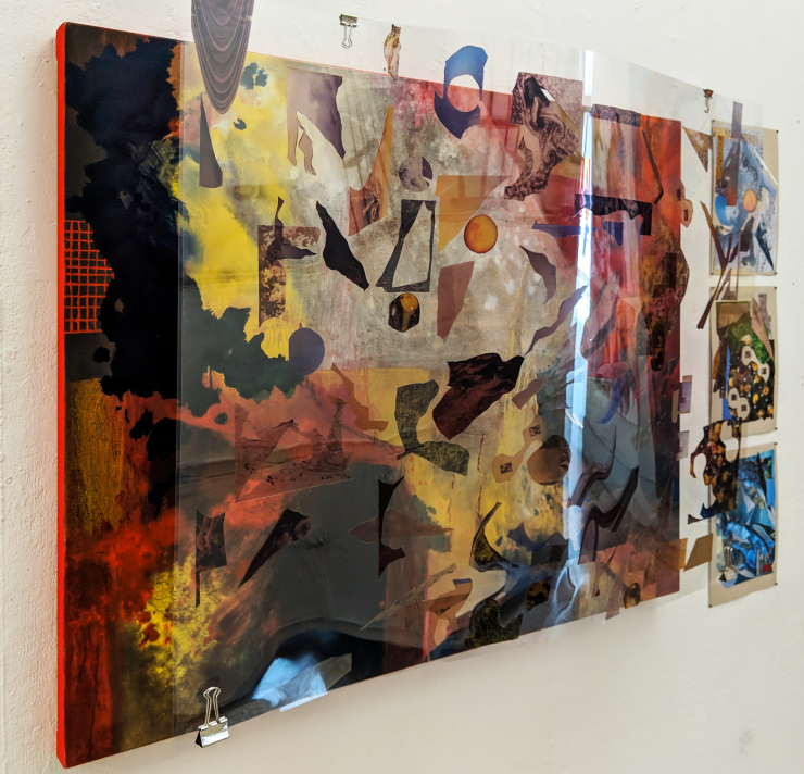 This is an abstract oil painting with a translucent collage suspended in front of it.