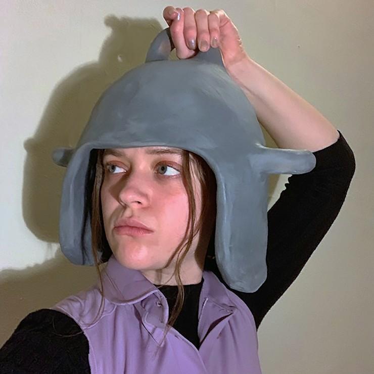 Helmet On. Bisque earthenware, spray paint