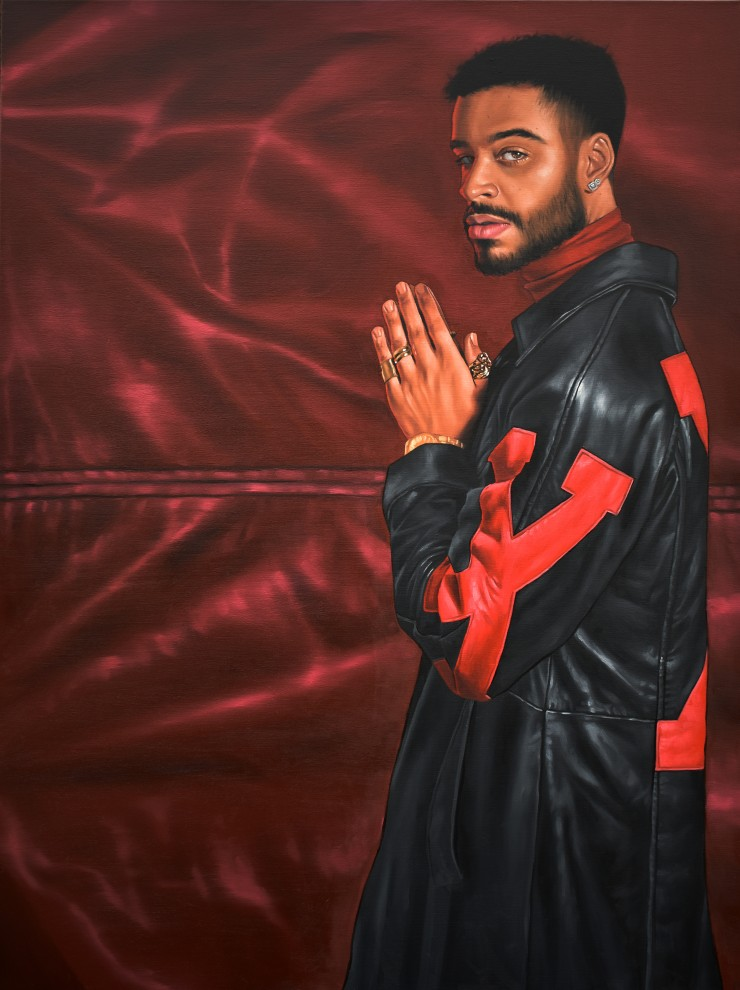 "Painting of a man wearing long leather ""X"" jacket, while holding up prayer hands"