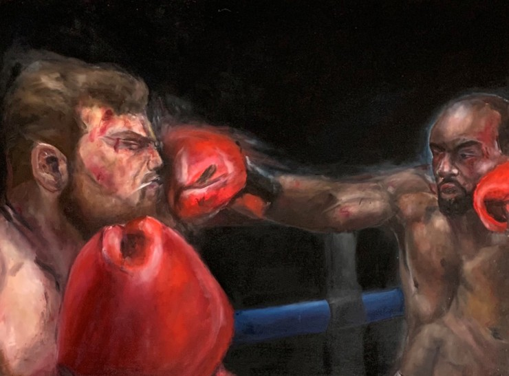 Boxer punching another in the face