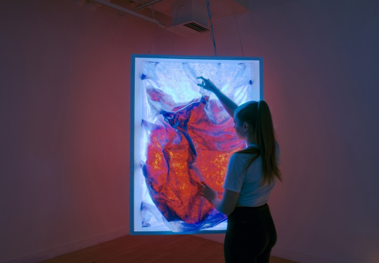 Installation using light and tactile fabric.