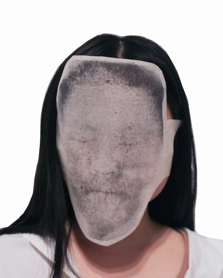 """The series ends with """"Is Barbarism With a Human Face Our Fate?"""" which is a series of photo-transferred human masks. The artist collected scans of human faces from people all over the world and made them into masks. By making and wearing them, the artist t"""