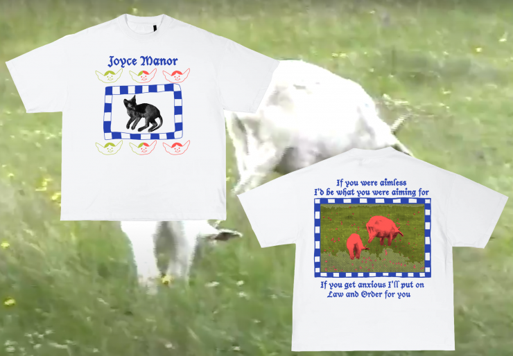 """A white t-shirt with an image printed on it that reads """"Joyce Manor"""" in blue ink. Underneath the text are two rows of smiling baby angel heads printed in a slime green to orange gradient. In between the two rows theres a picture of a black cat w"""