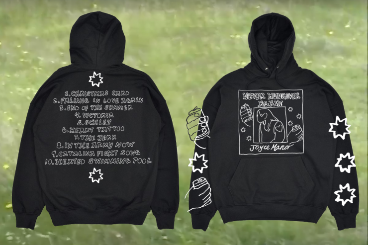 """A black hoodie with hand drawn bubble letters that read """"Never Hungover Again, Joyce Manor"""" A square printed on the center of the hoodie contains a girl looking away with a heart tattoo on her arm. On the outside of the square there are two hand"""