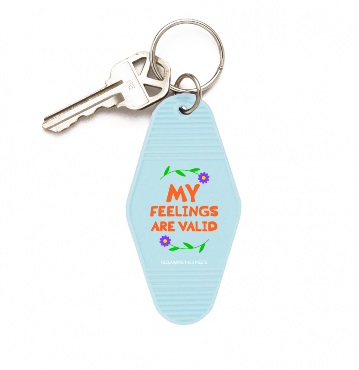 A series of 3 diamond-shaped keychains with added raised line texture on the top and bottom, with a phrase in the middle of the keychain (Don't talk to me, My feelings are valid, and Stay away from me) in various typefaces/compositions.