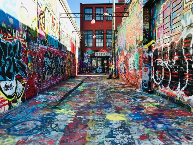 """With the development of tourism, the distance between continents has been narrowed infinitely.Tourists' footprints are also left all over the world in infinite ways.This is Graffiti Alley in Baltimore, and I use """"I've Been Here"""" as a symbol for"""