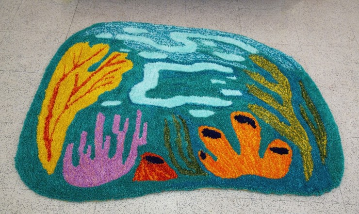 Tufted carpet with an underwater coral scene.