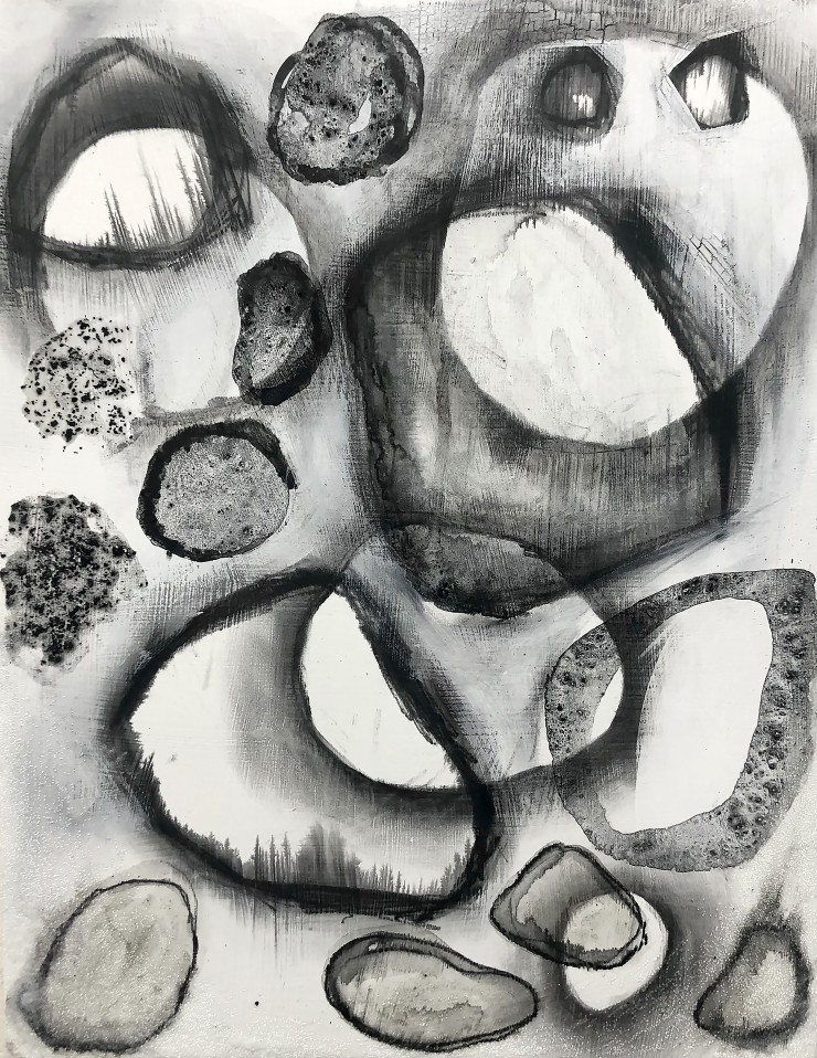 Overlapping black circles of varying opacity and texture on a white background.