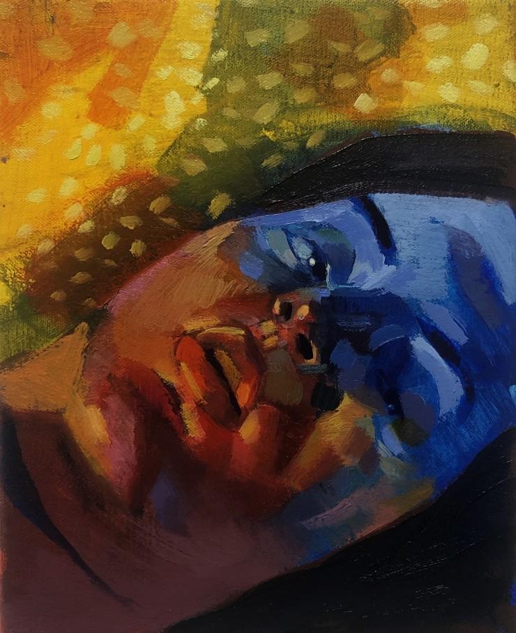 A half blue and half orange portrait.