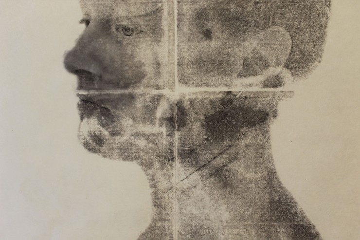 Two black and white portraits of the same woman, facing opposite directions. Depicted in a textural, abstract variety across the picture plane, almost like watercolor painting, with a set of gridded axes imposed through the middle of each.