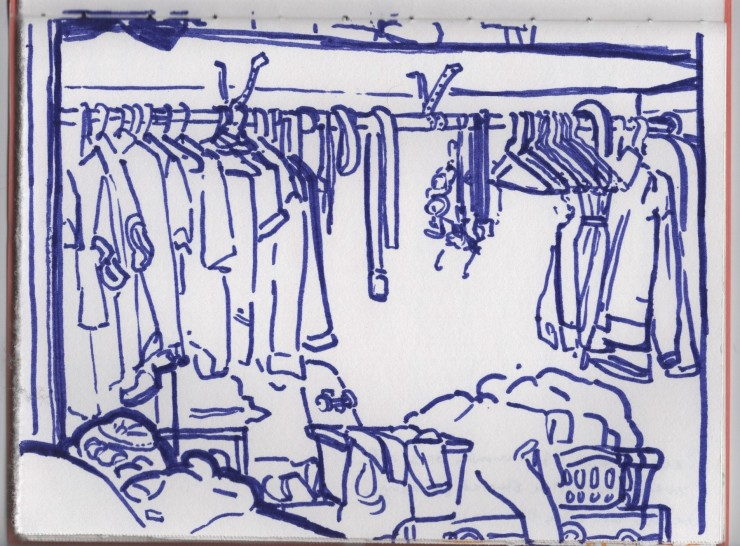 A line drawing of a cluttered closet done in a purple marker on white paper