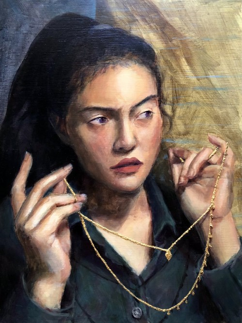 This work, Reflection, depicts a portrait of a girl holding a necklace up, close to her neck. Her eyes are looking somewhere off the painting with a dissatisfied expression which may be caused by seeing her reflection in a mirror. The necklace itself is m