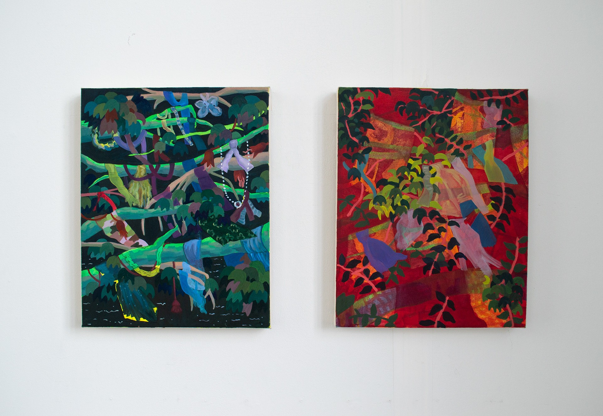 Two paintings of dense foliage hanging side by side